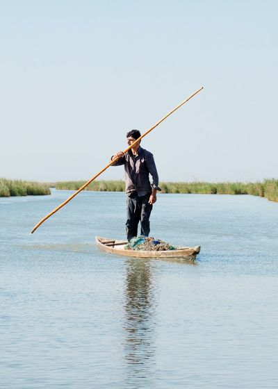 Fishing Men Occupation One Person Adult Fisherman People Only Men Full Length Sea Nature One Man Only Outdoors Fishing Net Adults Only Water Clear Sky Day Sky Working EyeEmSelect Nikon Shadegan Iran This Is Masculinity