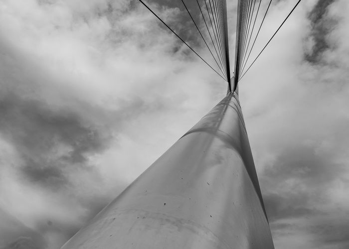 Sky Cloud - Sky Low Angle View Nature Day No People Outdoors Mode Of Transportation Transportation Airplane Air Vehicle Tall - High Fuel And Power Generation Metal Motion Technology Beauty In Nature Single Object Plant Directly Below Power Supply Cosenza Calatrava Calatrava Style Calatravaarchitecture Calatravabridge Blackandwhite Black And White Shadow Shadows & Lights Shadows The Minimalist - 2019 EyeEm Awards