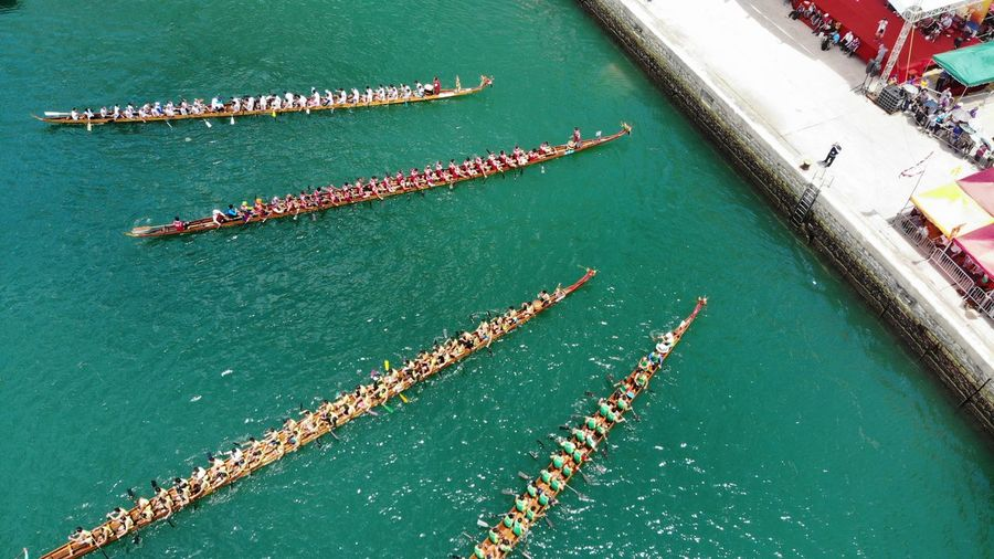 dragon boat racing in sham kei wan Dragon Boat Dragon Boat Festival Dragon Boat Race Race Contest Sport Sea Traditonal Traditional Festival Hong Kong China Chinese Festival Boat Canoeing Canoe Waterfront High Angle View Drone Photography Dronephotography Droneshot Aerial View
