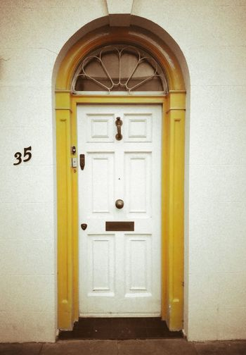The yellow door Door Closed Entrance Safety Arch No People Doorway Day Built Structure Yellow Entry Architecture Outdoors Notting Hill London
