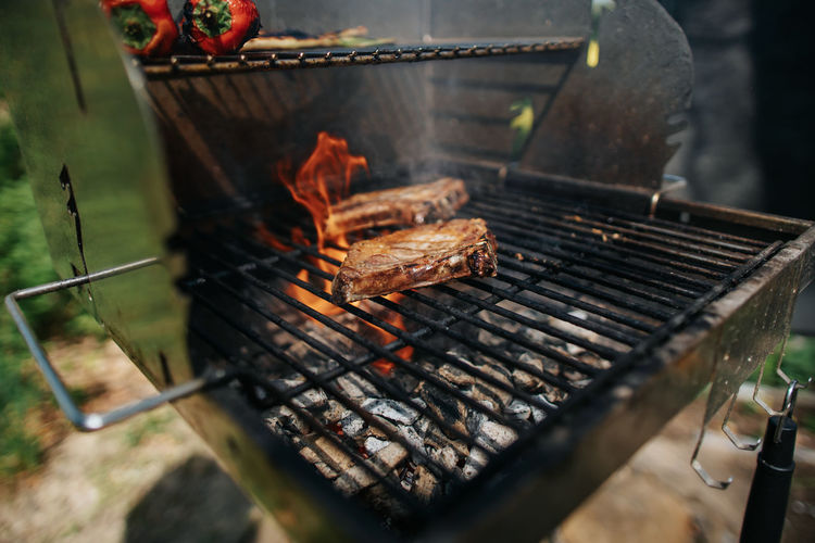 Two iberico chops on a grill with high flame