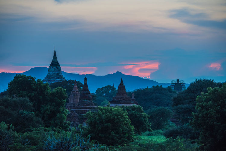 Silhouette of pagodas at sunset