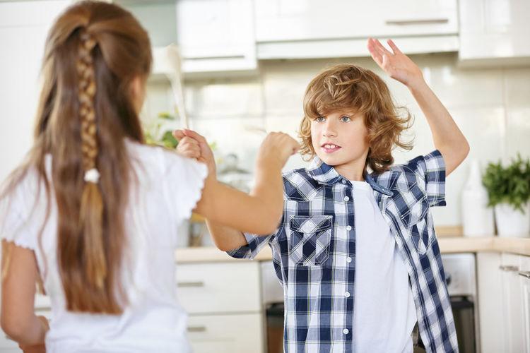 Siblings fighting at home