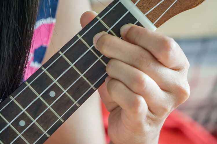 Artist Arts Culture And Entertainment Close-up Finger Focus On Foreground Guitar Hand Holding Human Body Part Human Hand Music Musical Equipment Musical Instrument Musical Instrument String Musician One Person Playing Plucking An Instrument Real People Skill  String String Instrument