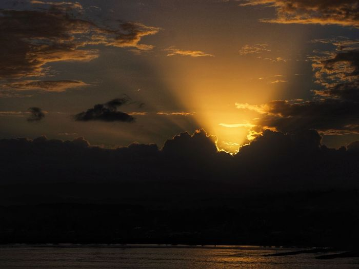 Water Beauty In Nature Sky Sunset Scenics - Nature Tranquility Sea Silhouette Idyllic Nature No People Night Waterfront Land Cloud - Sky