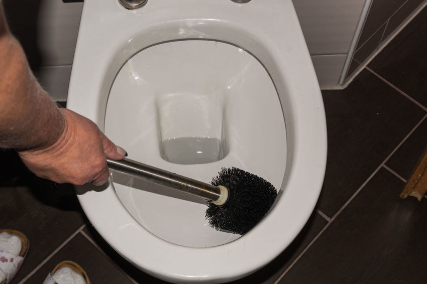 Cleaning a toilet with a toilet brush Bathroom Cleaning Directly Above Domestic Room Food And Drink Hand High Angle View Holding Home Household Equipment Human Body Part Human Hand Hygiene Indoors  Lifestyles Men One Person Real People Washing