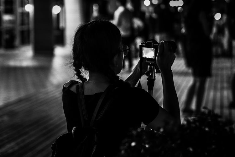 Gf8 Black And White Shadows & Lights Blackandwhite Photography Streetphotography Candid Photography Portrait Photo Messaging Photography Themes Technology Wireless Technology Camera - Photographic Equipment Photographing Women Filming Selfie Digital Single-lens Reflex Camera Camera Head And Shoulders Photographer SLR Camera