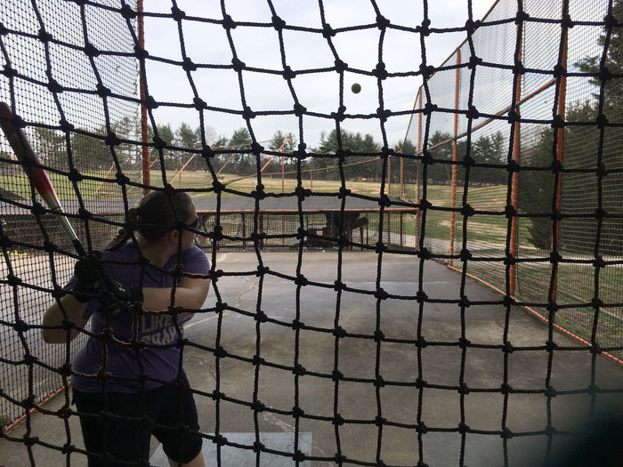 Batting cages in Maryland One Person Real People Lifestyles Leisure Activity Fence Casual Clothing Boundary Barrier Day Standing Young Women Chainlink Fence Women Young Adult Full Length Nature Glasses Child Outdoors Hairstyle Batting Cages Slow Pitch Softball Sport Baseball