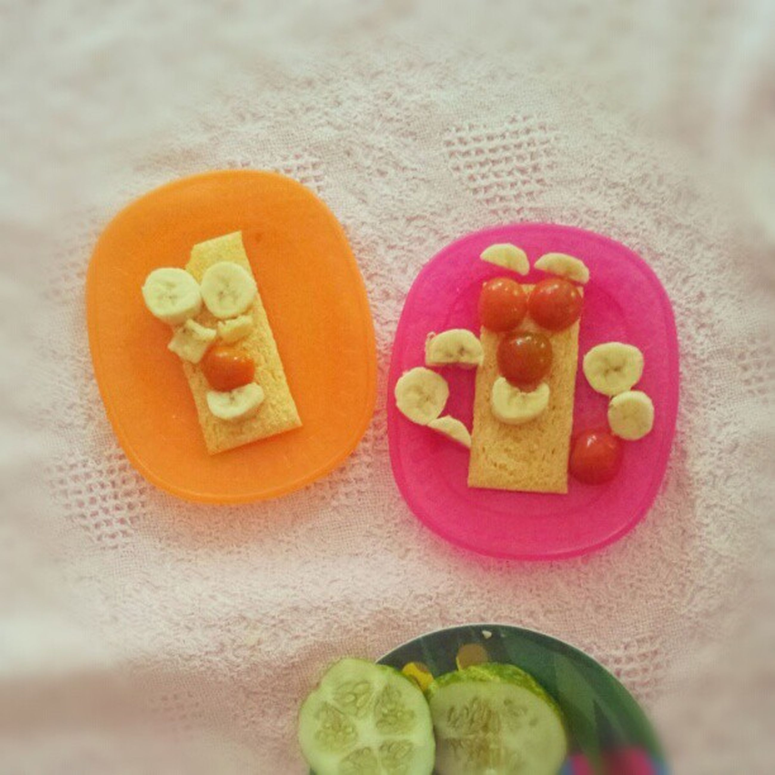 food, indoors, food and drink, still life, sweet food, multi colored, freshness, close-up, indulgence, table, unhealthy eating, creativity, text, ready-to-eat, high angle view, heart shape, art and craft, dessert, western script, anthropomorphic face