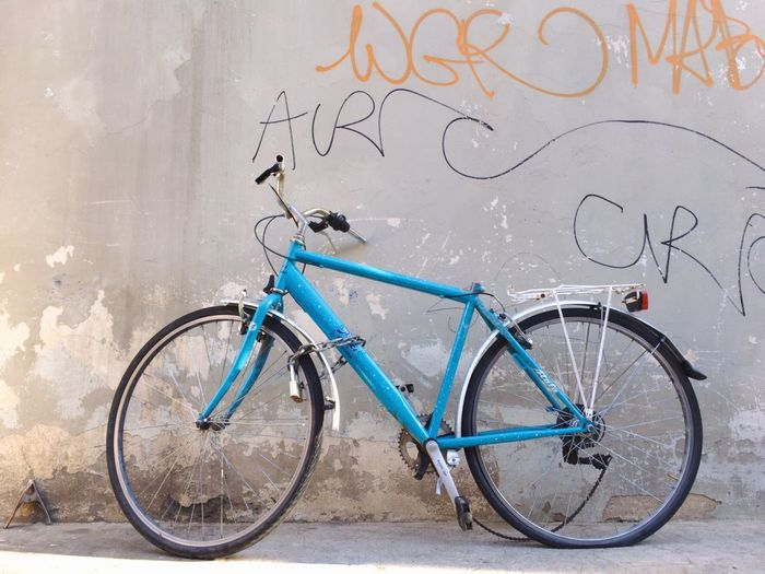 Bicycle against graffiti wall