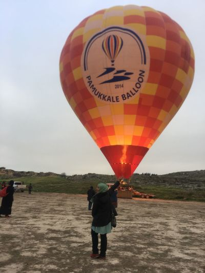Rear view of people with hot air balloon