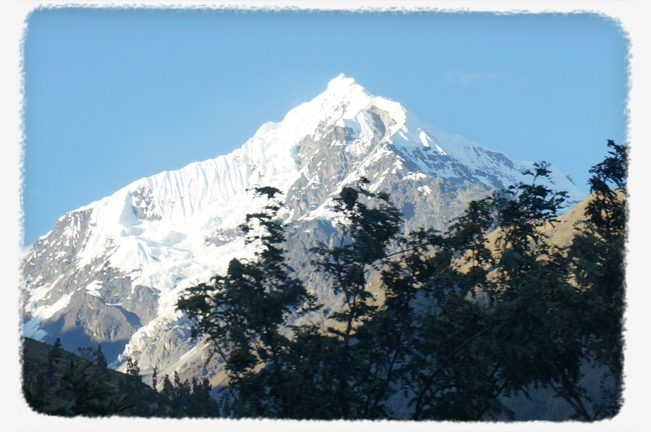 snow, cold temperature, mountain, winter, snowcapped mountain, transfer print, season, tranquility, scenics, tranquil scene, mountain range, beauty in nature, clear sky, blue, nature, weather, auto post production filter, low angle view, sky, majestic