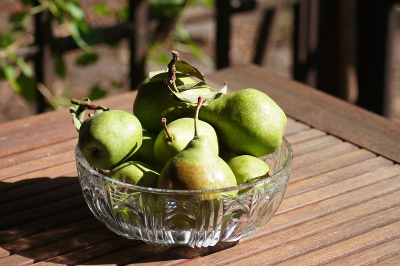 Fresh pears in the bowl Apple Bowl Close-up Container Day Focus On Foreground Food Food And Drink Freshness Fruit Granny Smith Apple Green Color Healthy Eating Household Equipment No People Outdoors Pear Still Life Table Wellbeing Wood - Material