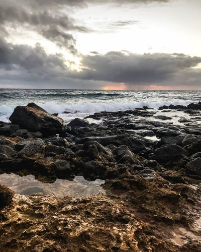 Sunrise in Hawaii Clouds Beach Beach Kauai Hawaii Sky Water Beach Sea Land Cloud - Sky Beauty In Nature Scenics - Nature Tranquility Nature No People Outdoors Rock Tranquil Scene Sunlight Horizon Over Water