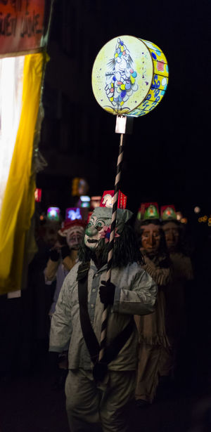 Basel carnival 2017. A carnival participant in costume carrying an illuminated stick lantern on monday morning in the streets. Picture taken on 6 of March 2017. Schneidergasse in Basel Switzerland. Basel Carnival Carnival Crowds And Details Event Lantern Tourist Attraction  Tradition Travel Candid Celebration Colorful Costume Illuminated Leisure Activity Mask - Disguise Morgenstreich Multi Colored Night Outdoors Parade People Real People Shrove Tuesday Streetphotography Switzerland