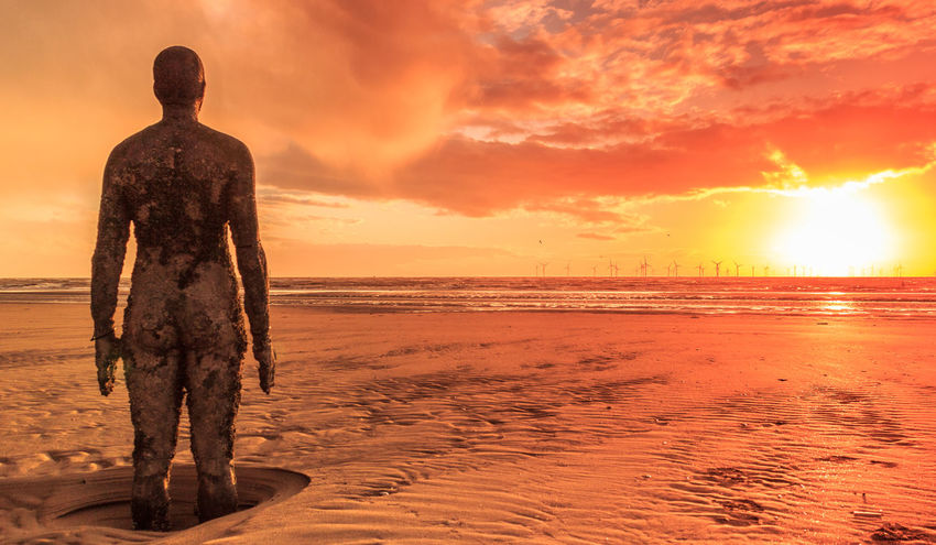 Another Place art installation by Anthony Gormley, on Crosby Beach near Liverpool at sunset Anthony Gormley Art Installation Cloud Crosby Beach Dramatic Sky Iron Man Liverpool England Statue Sunset_collection United Kingdom Windmills Algae Another Place By Anthony Gormley Art Beach Golden Hour Orange Colour Outdoors Ripples In The Sand Sand Sea Statues Sun Sunset Water