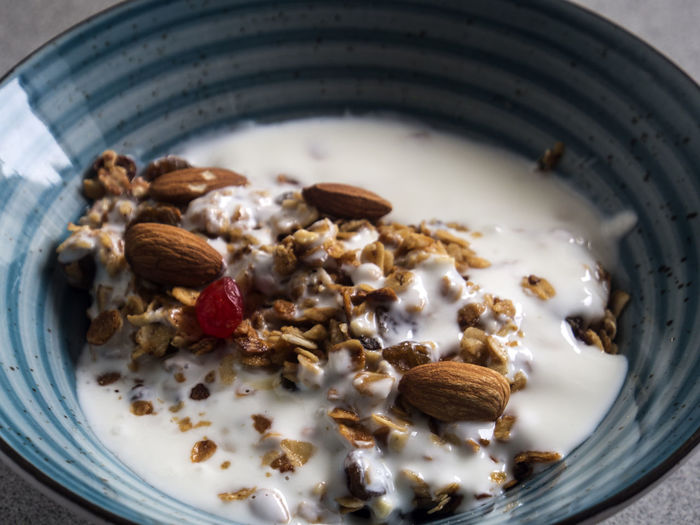 Bowl with granola on grey background Background Bowl Breakfast Close-up Day Dried Fruit Food Food And Drink Freshness Fruit Fruits Granola Grey Hazelnut Healthy Eating Indoors  No People Nut - Food Oat Flake Peanut - Food Peanut Butter Protein Bar Raisin Ready-to-eat Walnut