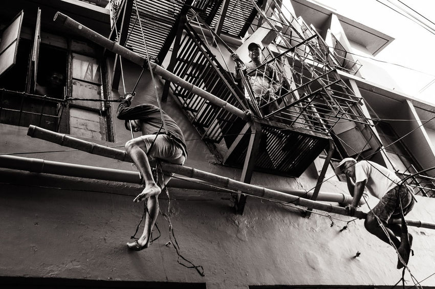 Balancing act. Quiapo district of Manila and environs. Building Built Structure Day Everydayscenes Low Angle View People Photography Repairman Scaffolding Street Photography Workers Working Showcase June