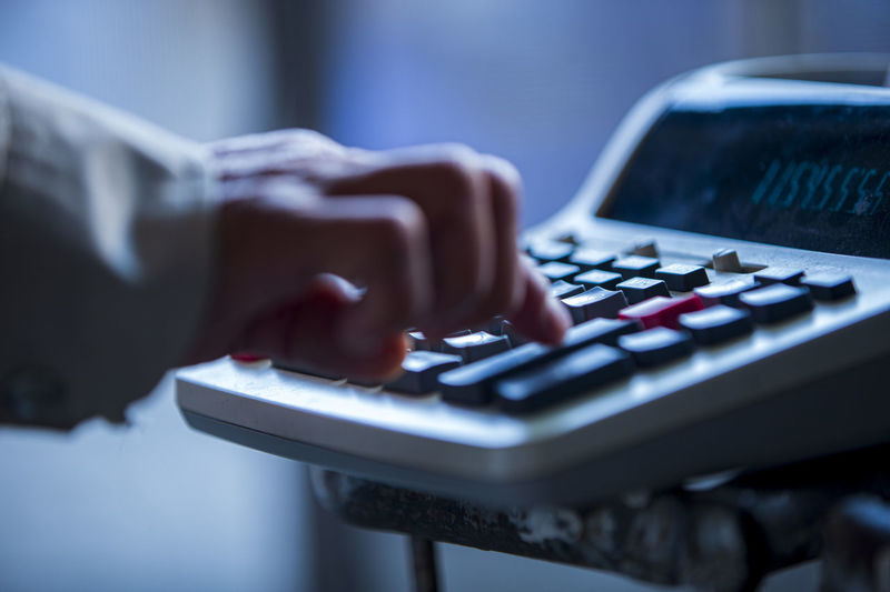 Close up of a person using a calculator