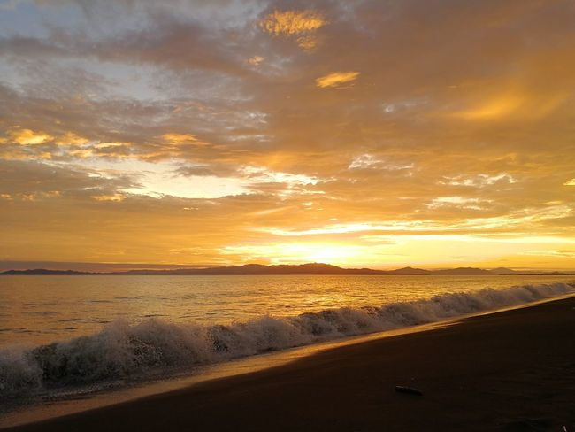 Puntarenas, Costa Rica. Sunset Landscape Sand Scenics Dramatic Sky Sea Reflection Beach Summer