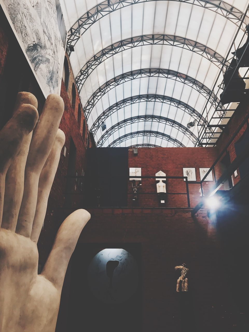 real people, architecture, human hand, indoors, built structure, people, hand, lifestyles, men, human body part, day, holding, sunlight, leisure activity, arch, body part, unrecognizable person, window, ceiling, finger