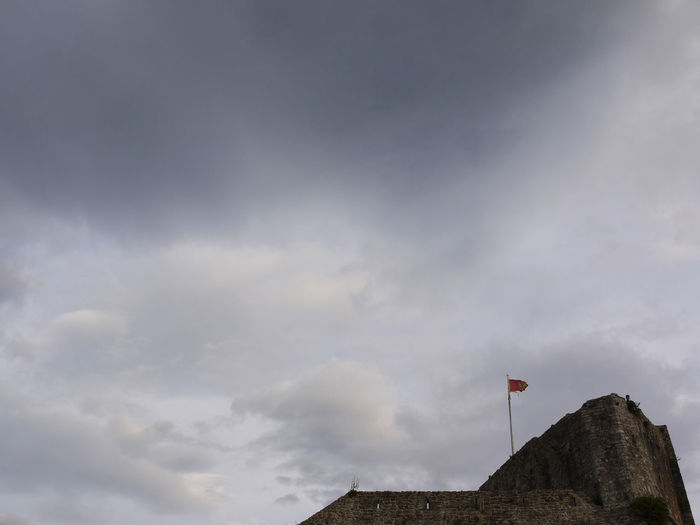 Cloudy sky in Budva, Montenegro Anxious  Architecture Budva Budva Old Town Cloud Cloud - Sky Cloudy Disquieting Flag Fortness Low Angle View Montenegro No People No People Outdoors Outdoors Sky Solitude