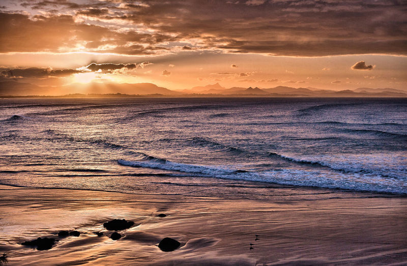 Sun setting at Wategoes Beach at Byron Bay Sunset Sky Water Sea Beauty In Nature Scenics - Nature Cloud - Sky Orange Color Tranquil Scene Beach Land Tranquility Nature Idyllic Sun Wave Horizon Over Water Horizon Motion No People Beautiful Ocean Seascape Landscape Sand