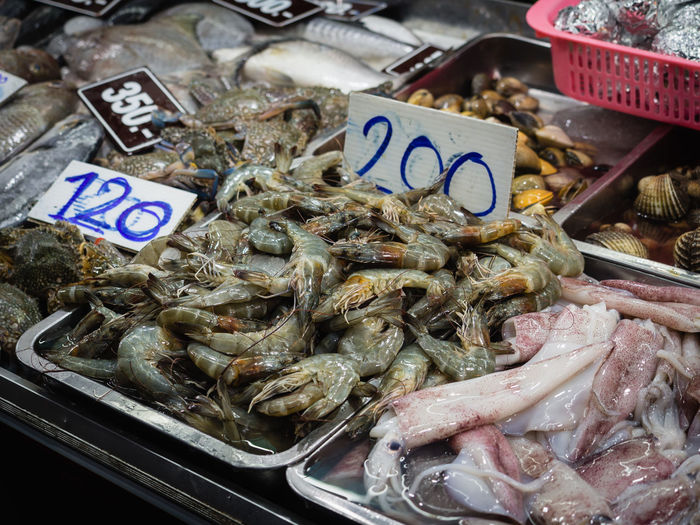 Food And Drink Food Seafood Freshness For Sale Fish Choice Market Price Tag Wellbeing Vertebrate Healthy Eating Still Life Retail  Variation Business High Angle View Animal Raw Food No People Fish Market Sale Retail Display Thailand Squid Assortment Variety Market Stall Stall Various