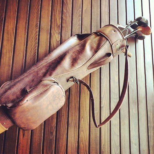Vanguard Made , Nice Vintage leather golf bag with clubs in it hang on the wall at tgifridays fridays, taken by my sonyericsson sony xperia arc, medina madinah madina ksa saudi_arabia saudiarabia saudi arabia, جولف مطعم فرايديز المدينة_المنورة المدينة المنورة