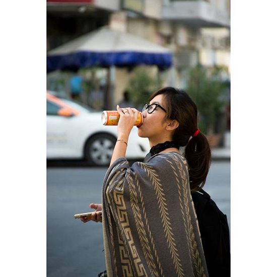 Thirst Bokeh Street Streetphotography IPhone Lady Portrait Multitasking Nikontop Nikon People Igers IGDaily Photooftheday Candid Mirinda Nikon_photography_