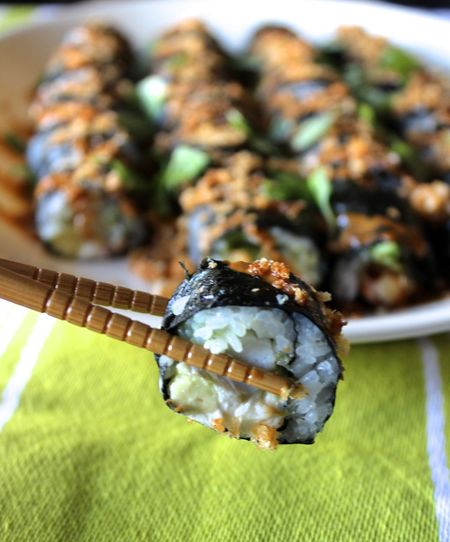High angle view of chopsticks with sushi over table