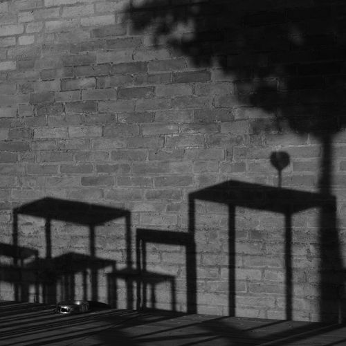 Appetizer for two Wall Wall - Building Feature Built Structure Brick Wall Outdoors Silhouette Lifestyles Streetphotography Streetphoto_bw Blackandwhite Black And White Bnw_captures Bnw_collection Bnw_life Appetizer