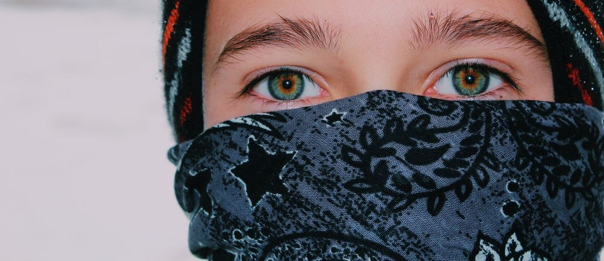 Close-up portrait of woman covered with snow