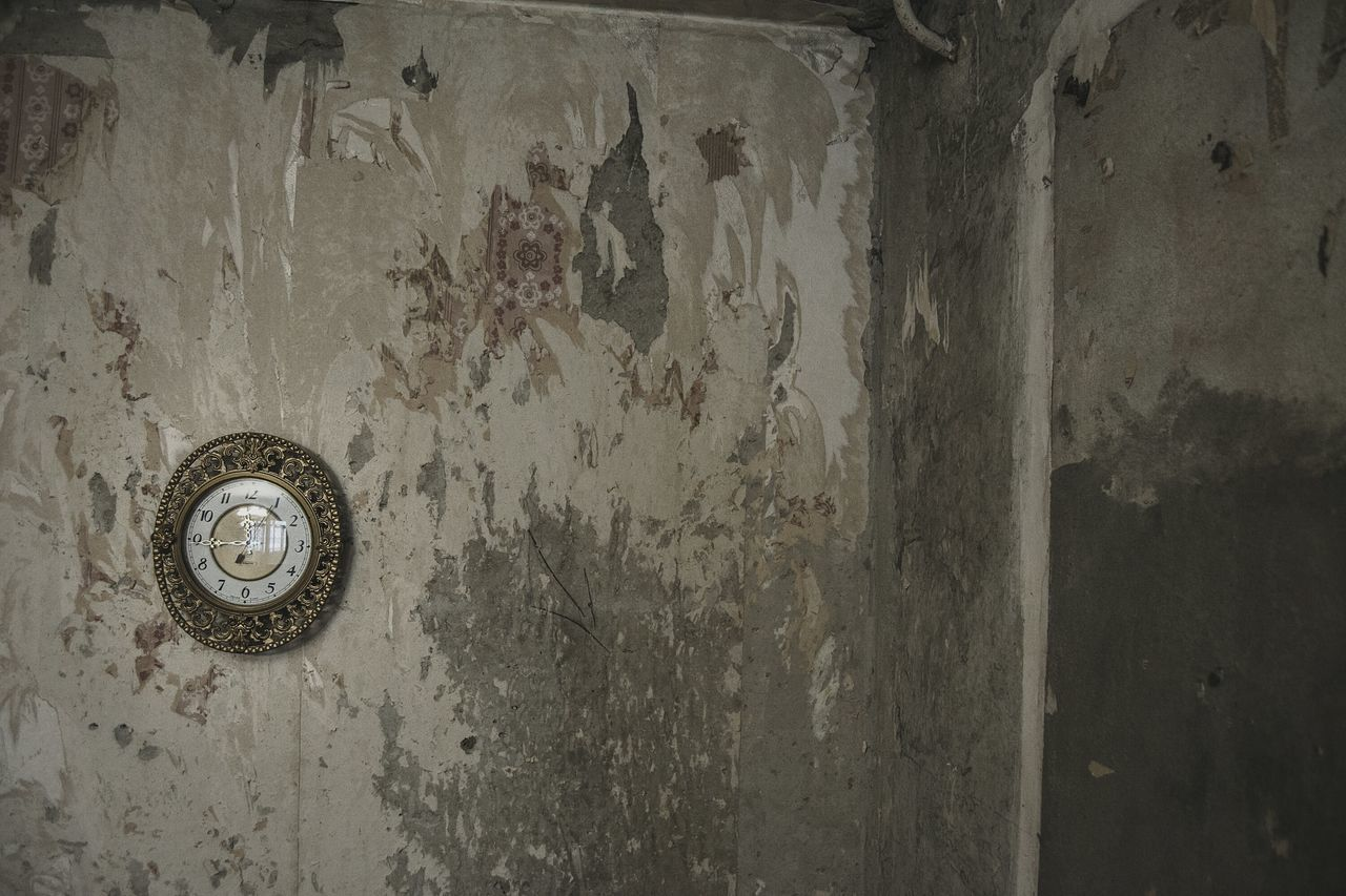 Antique Old Clock Mounted On Weathered Wall