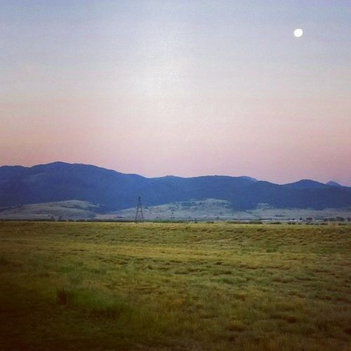Scenic Montana Landscape at Dawn with Supermoon Montanamoment Moonset