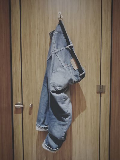 Jeans Hanging On Closed Door