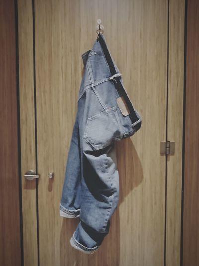 Jeans hanging on closed door