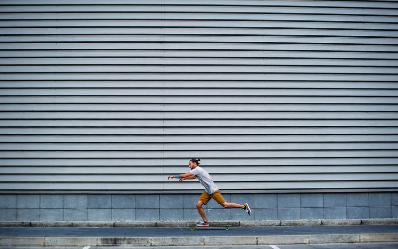 Side view of man running on staircase