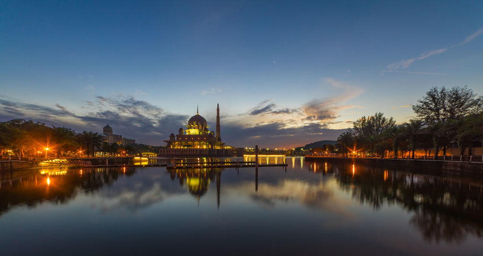 Putra Mosque during blue hour Architecture Built Structure Calm Cloud Cloud - Sky Malaysia Malaysia Truly Asia Mosque Mosques Nature No People Outdoors Putrajaya Reflection Scenics Sky Standing Water Sunrise Sunset Tourism Tranquil Scene Tranquility Travel Destinations Tree Water