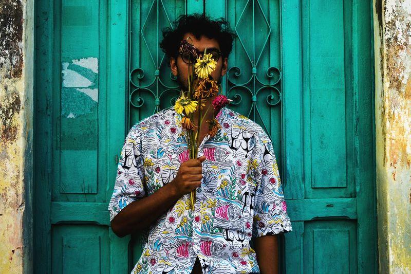 waiting 2 EyeEmNewHere EyeEm Best Shots Urban Mexico Self Portrait Selfportrait Urbanphotography Flower Flower Head Standing Door Men Front View Architecture Building Exterior Blooming Closed Door Entryway Door Knocker
