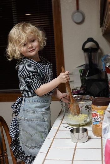 My granddaughter making Peanut Butter Cookies. Smiling Wooden Spoon Happiness Christmas Cookies! Cute Girl Baking Baking Cookies EyeEm Best Shots EyeEm Christmas Photography Making Cookies! Making Memories