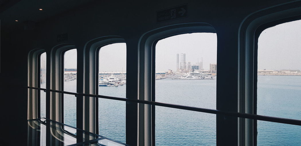 Water Architecture Window Sea Built Structure Nature Nautical Vessel Day Sky Indoors  City Transparent Transportation Building Travel No People Mode Of Transportation Arch Cityscape Skyscraper Cruise Ship