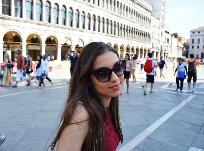 Portrait Of Young Woman At St Marks Square In City