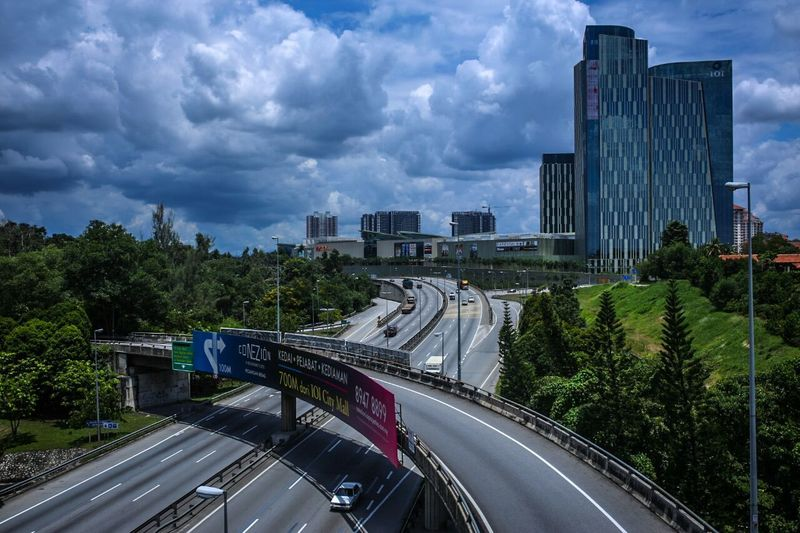 highway City Street Tree Road Modern Cityscape City Traffic Architecture Business Finance And Industry Highway City Life Speed Built Structure Outdoors Skyscraper Bridge - Man Made Structure Urban Road No People Day Dramatic Sky Building Exterior Sky Architecture Abstract Astronomy The Street Photographer - 2017 EyeEm Awards