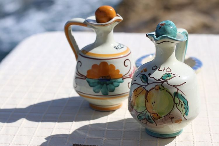 Close-up of decorative jugs on table
