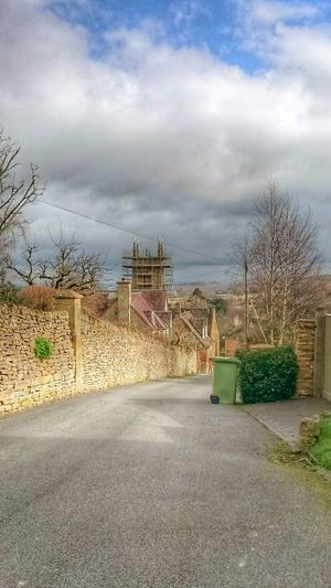 Taking Photos EeYem Best Shots Thewayforward From Where I Stand Hdr_Collection Architecture_collection Old Buildings Cotswoldvillages Structure And Nature Stonewall Road Country Road Landscape Landscapes Landscape_photography Clouds And Sky Stone Wall Cloudscape Church Trees And Sky Trees