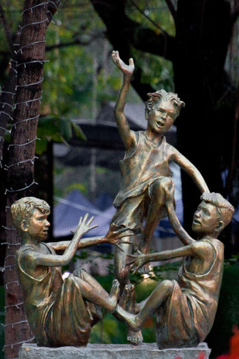 Luksong Tinik (Jumping Over Thorns) Traditional Filipino Game Playing Games Playing Daylight Photography Tree Branches Tree Branch  Bokeh Bokeh Background Sculpture Sculpture In The City Children Statue Boys Playing Filipino Game Luksong Tinik Jumping Over Thorns Popular Filipino Game Statue Bronze Statue Quezonmemorialcircle Quezon City Park Park - Man Made Space DSLR Canonphotography Outdoors Daylight No People Human Representation Male Likeness Sculpted