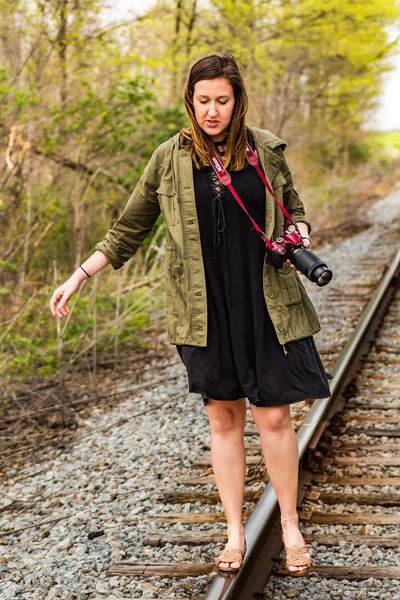 Adult Adults Only Brown Hair Casual Clothing Day Front View Full Length Lifestyles Nature One Person One Woman Only Outdoors People Photographer Portrait Railroad Track Real People Standing Tracks Tree Walking Young Adult Young Women