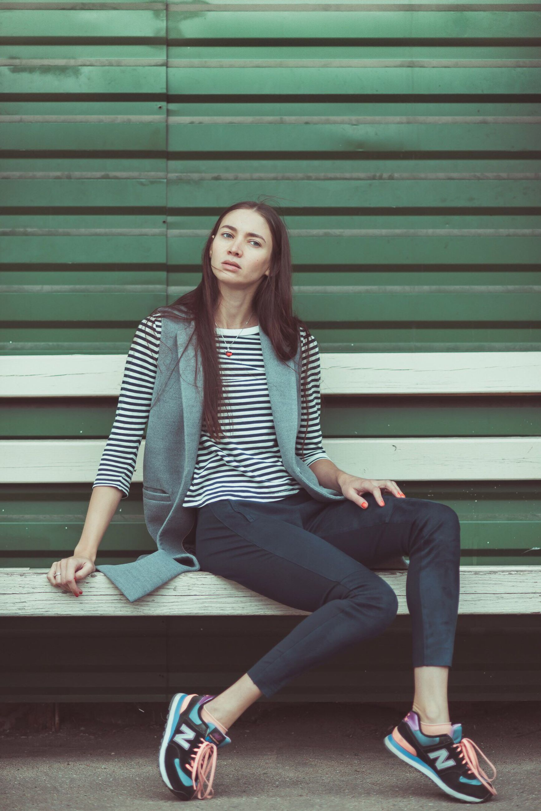 young women, young adult, sitting, full length, casual clothing, lifestyles, leisure activity, person, long hair, cross-legged, looking at camera, day, medium-length hair, well-dressed, fashionable
