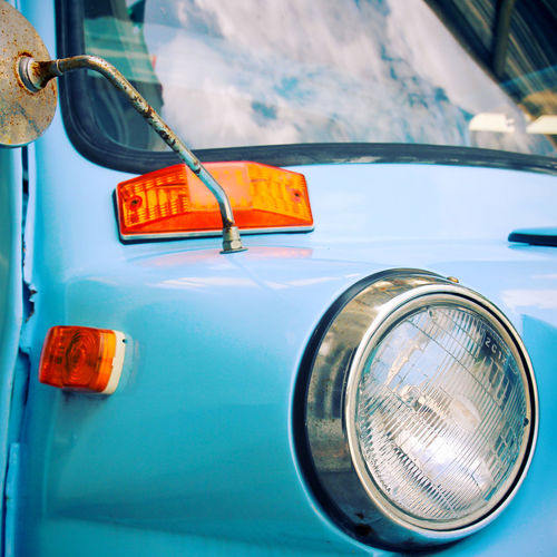 Mode Of Transportation Transportation Land Vehicle Car Motor Vehicle Headlight Day Vintage Car Retro Styled No People Close-up Blue Focus On Foreground Outdoors Metal Lighting Equipment Safety Reflection Orange Color